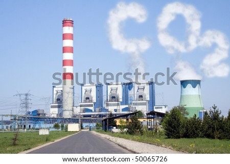 Power plant with chimney and cooling towers with CO2 clouds