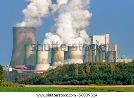 Power plant with huge cooling towers, in contrast to its nice surrounding area