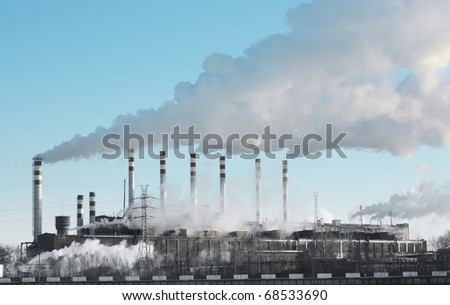 Power plant with pipes and smoke