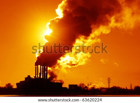 Power plant with smoke and dirty orange air
