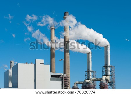 power plant with smoking chimneys in Rotterdam, Netherlands