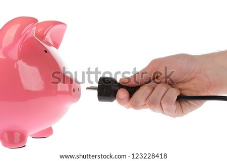 Power plug in a hand on a white background