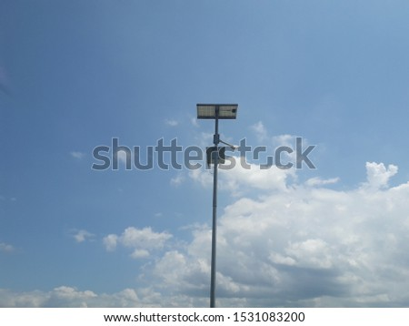 Power pole or light poles against clouds on blue sky background