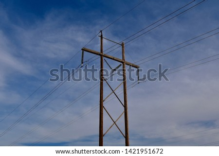 Power Poles and Power Lines On Blue Sky