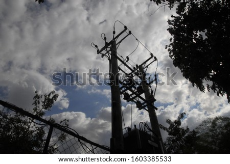 Power poles and wires on the city roadside