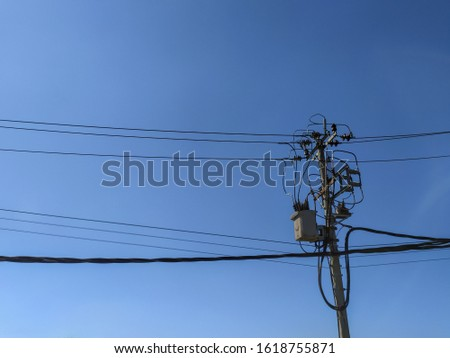 Power poles, cables and blue sky, good for advertising electricity resources.