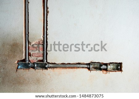 power receptacle steel boxes and conduit have install in the old brick wall #1484873075