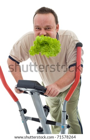 Power slimming concept with overweight man on exercise machine eating fresh green salad - isolated
