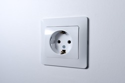 power socket on the empty white wall