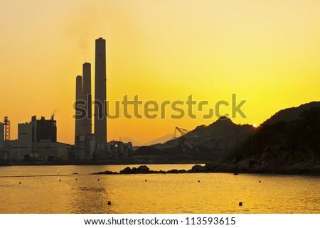 Power station along coast at sunset in Hong Kong