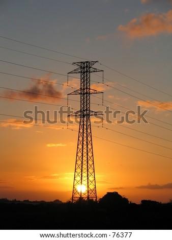 Power supply pylon over a sunset