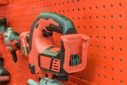 Power tools on display stand. Colors - red, black. Power tool shop concept. Selective focus.