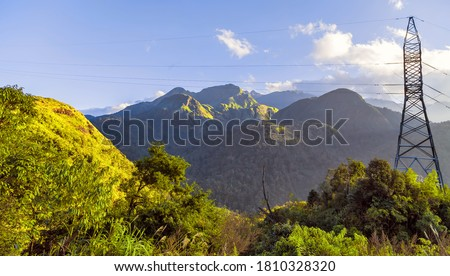 Power tower, electricity pylon. Green Landscape with blue sky View Mountains Range. Photo stock ©