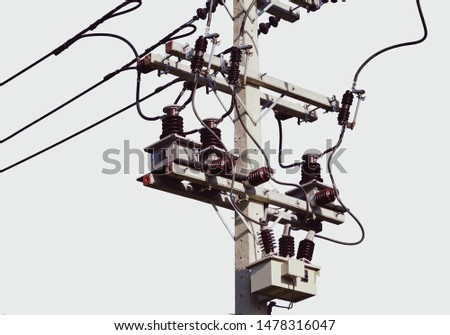 Power transformer. Electrical energy transfer to end users through distribution transformer on concrete pole changing high voltage to low voltage #1478316047
