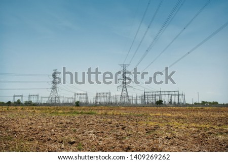 Power transmission, Electric power lines and power plant background.