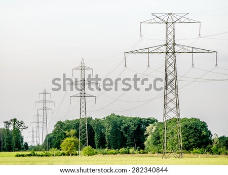 Power (transmission) line running off into the horizon just across the Swiss border outside Ferney-Voltaire, France. 2015.