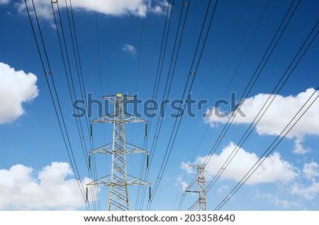 Power transmission lines against blue sky / Power transmission lines
