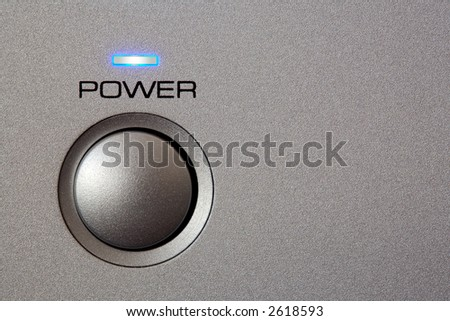 Powerbutton - close-up. Copyspace on grey/silver front.