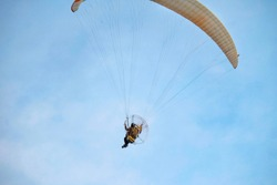 Powered Paragliding or Paramotoring (PPG) : human flying with motor on the back and parachute for travelling.