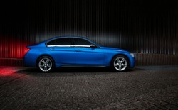 Powerful beast sedan in blue color, with carbon fiber