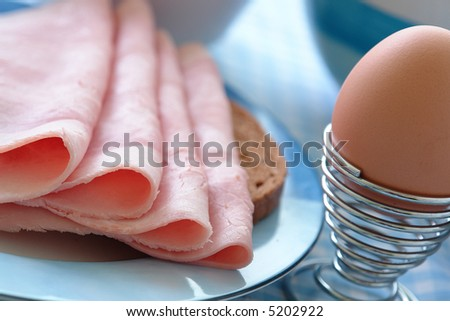 Powerful breakfast with a loaf of bread and ham and eggs