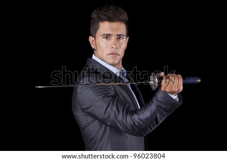 Powerful businessman holding a ninja sword (isolated on black)