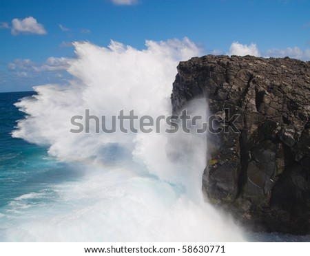 Powerful crashing waves against rocks in Mauritius