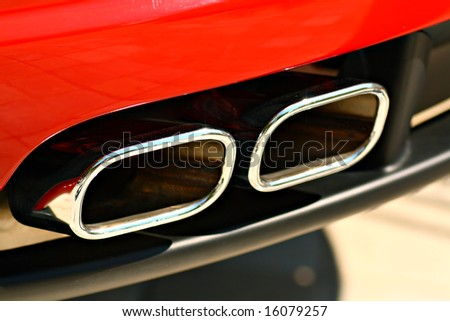 Powerful double exhaust of a red sports car