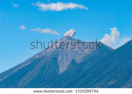 Powerful explosion of volcano called Fuego, Elevation: 3763 m in Guatemala, Central America. Natural disaster, destruction and death. #1310288746