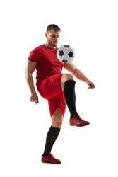 Powerful, flying and running above the field. Young football soccer player in action, motion isolated on white background. Concept of sport, movement, energy and dynamic, healthy lifestyle.