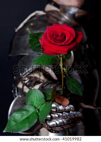 Powerful heavy fighter with red rose - stock photo