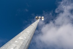 Powerful LED light on a aluminum metal pole , cloudy sky background. Concept sport event, game. Modern light source