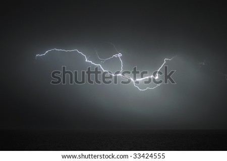 Powerful lightning during thunderstorm over the sea