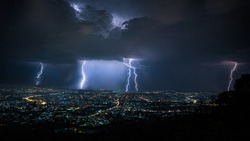powerful lightning storm over city