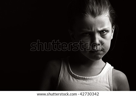 Powerful Low Key Shot of a Child with Attitude