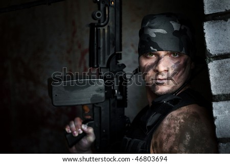Powerful mercenary with submachine gun - stock photo
