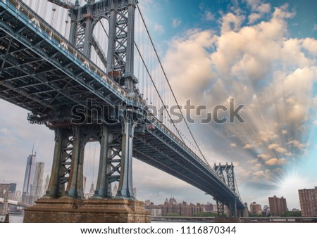 Powerful metallic structure of Manhattan bridge against a beautiful blue sky. #1116870344