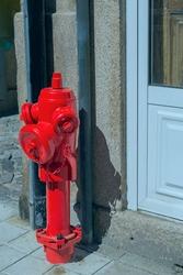powerful modern hydrant for extinguishing a fire on a Lisbon street