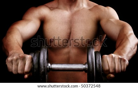 Powerful muscular man holding metal workout weight
