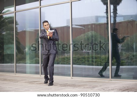 Powerful security businessman aiming a gun
