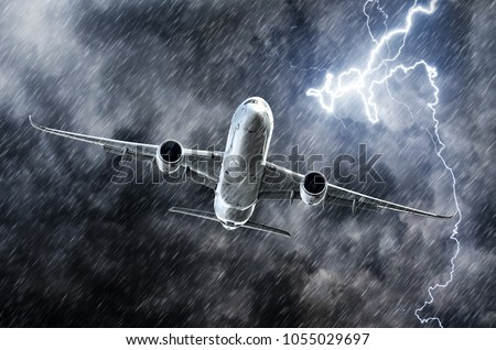 Powerful thunderstorm lightning strike and heavy rain in the sky passenger airplane