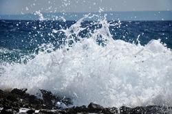 Powerful Waves crushing on a rocky beach
