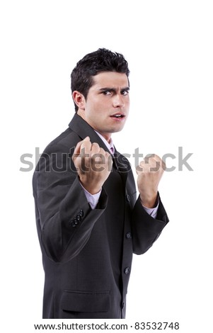 Powerful young businessman very angry with you (isolated on gray)