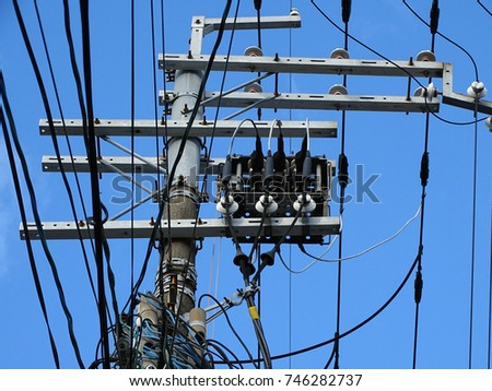 Powerline insulators, connectors and tangled wires on an electrical pole #746282737