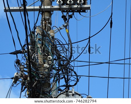 Powerline insulators, connectors and tangled wires on electrical pole #746282794