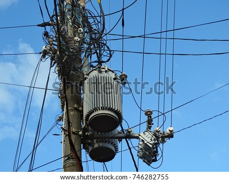 Powerline insulators, connectors, transformers and tangled wires on electrical pole #746282755