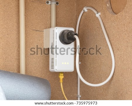 Powerline network adaper plugged into a wall socket - The Netherlands #735975973