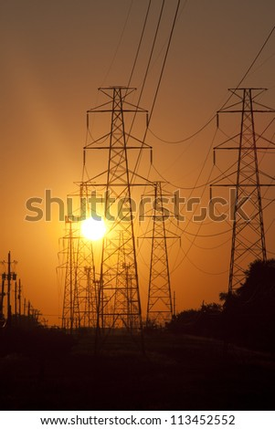 Powerlines disappearing into the sunset