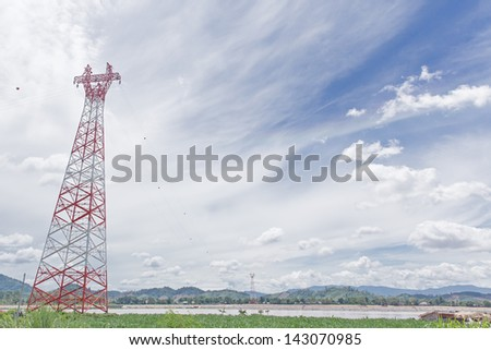 powerlines in a flat landscape and blue sky,High voltage pole
