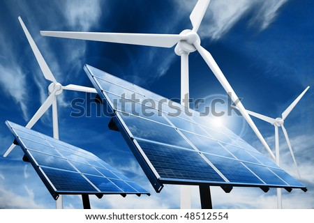 Powerplant with photovoltaic panels and eolic turbine - stock photo